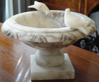 This small, but heavy, marble pedestal bowl was about $10.00