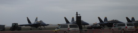 Blue Angels lined up on tarmac. Heat waves were visible all around the jets.