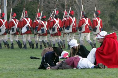 British Dragoons march past dead and wounded colonists as they head to Concord during the Revolutionary War battle reenactment on Patriots Day in Lexington, Monday, April 21, 2014.    Photo by Chitose Suzuki